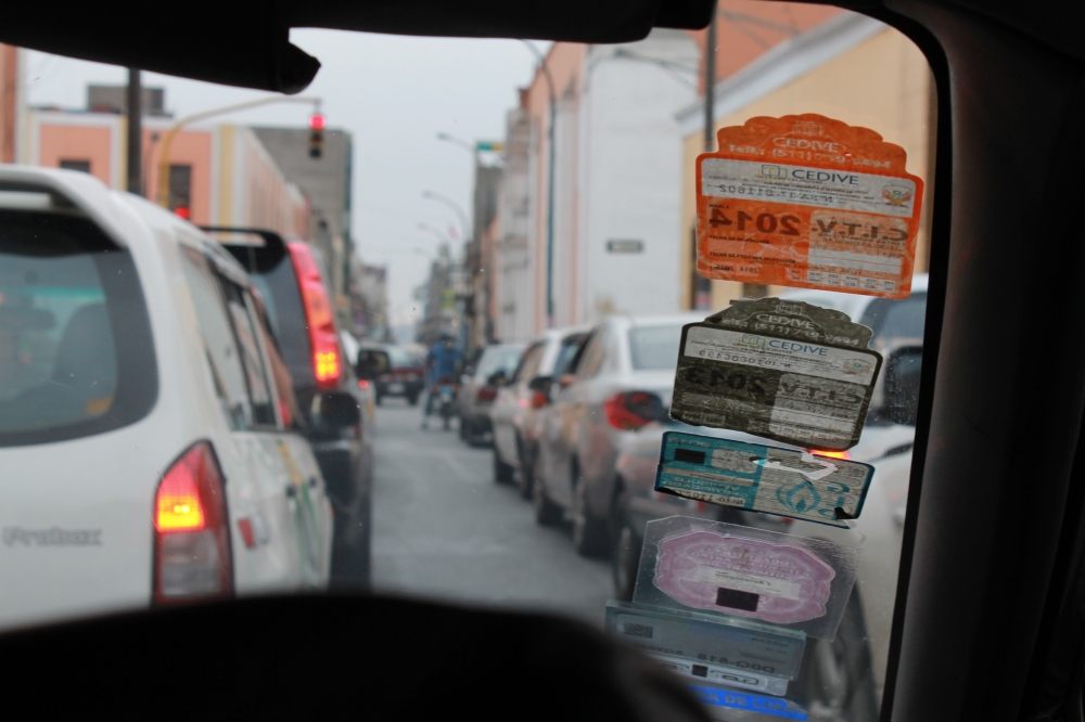A taxi driver's accumulated yearly permits displayed on his windscreen (photo: Alex Pashley)