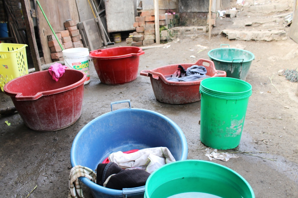 The Zela family's laundry production line. Water is a scarce resource and costs them $2 on two 30 liter buckets