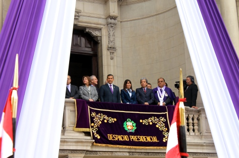Peru's President Ollanta Humala and ministers look on from the presidential balcony, before the leader came down to crowd level.