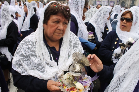 A 'sahumadora', one of 350 women chosen by the brotherhoods, who burn sweet incense during the procession from pure silver pots.