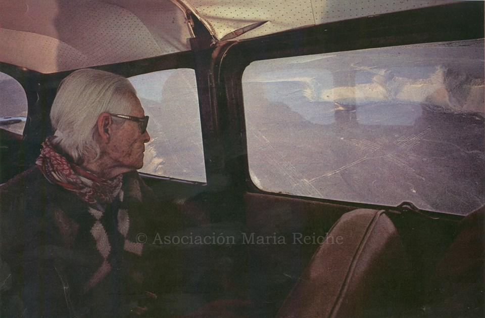 Maria Reiche, the first to map and measure the lines,  looking out to the Hummingbird geoglyph from a small aircraft (Photo: Maria Reiche Association)