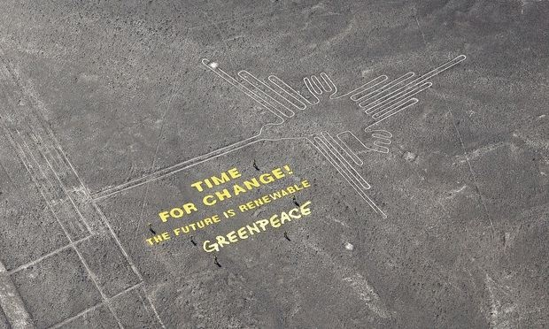Greenpeace's 'time for change' message next to the hummingbird geoglyph in Nazca. Photograph: Thomas Reinecke/TV News
